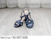 Blue women's leather sandals stand on the floor in the room. Стоковое фото, фотограф Володина Ольга / Фотобанк Лори