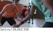 Diverse male basketball team and coach playing match. Стоковое видео, агентство Wavebreak Media / Фотобанк Лори