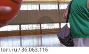 Diverse female basketball team practice dribbling ball, wearing face masks. Стоковое видео, агентство Wavebreak Media / Фотобанк Лори