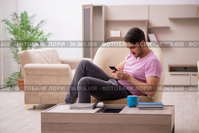 Young man siiting at home during pandemic