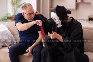 Devil visting old dying man at home