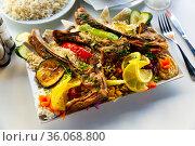 Rice pilaf with lamb meat and vegetables in rectangular bowl. Стоковое фото, фотограф Яков Филимонов / Фотобанк Лори