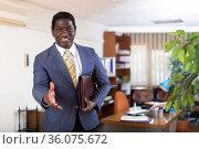 Successful african american businessman stretching open hand for handshake. Стоковое фото, фотограф Яков Филимонов / Фотобанк Лори