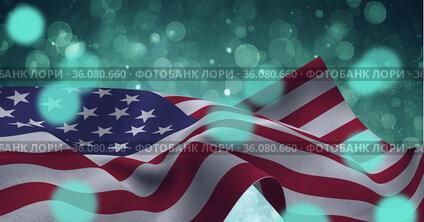 Composition of american flag billowing over defocussed bokeh blue lights on sunset sky
