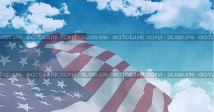 Composition of billowing american flag over cloudy blue sky