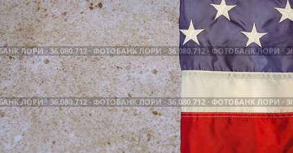 Composition of folded american flag on wood particle board