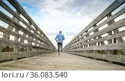Senior man is running on a long trestle over Long Pine Creek - recreational... Стоковое фото, фотограф Zoonar.com/Marek Uliasz / easy Fotostock / Фотобанк Лори