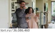 Happy diverse couple talking and drinking coffee in kitchen. Стоковое видео, агентство Wavebreak Media / Фотобанк Лори