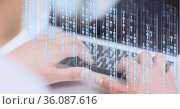 Binary coding data processing against mid section of person using laptop. Стоковое фото, агентство Wavebreak Media / Фотобанк Лори