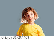 Adorable 5 year kid in yellow t-shirt posing on gray background. Стоковое фото, фотограф Zoonar.com/OKSANA SHUFRYCH / easy Fotostock / Фотобанк Лори