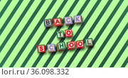 Composition of text back to school in coloured block letters over diagonal green stripes. Стоковое фото, агентство Wavebreak Media / Фотобанк Лори