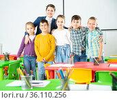 Teacher and happy children in classroom. Стоковое фото, фотограф Яков Филимонов / Фотобанк Лори