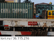 """""""Yangon, Myanmar, China Shipping Sea freight containers on a parked truck at the harbour"""" (2014 год). Редакционное фото, агентство Caro Photoagency / Фотобанк Лори"""