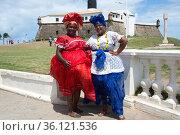 Bahia women with typical dresses in Barra lighthouse (Farol da Barra... (2016 год). Редакционное фото, фотограф J M Barres / age Fotostock / Фотобанк Лори