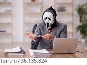 Devil businessman employee sitting at workplace. Стоковое фото, фотограф Elnur / Фотобанк Лори