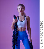 Young sportswoman with ropes poses in studio. Стоковое фото, фотограф Tryapitsyn Sergiy / Фотобанк Лори