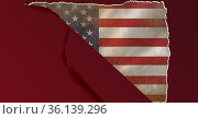 Composition of torn hole in red paper revealing vintage american flag. Стоковое фото, агентство Wavebreak Media / Фотобанк Лори