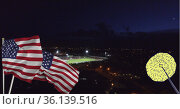 Composition of fireworks over stadium with american flags. Стоковое фото, агентство Wavebreak Media / Фотобанк Лори