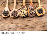 Closeup of five wooden cooking spoons in a row with various exotic... Стоковое фото, фотограф Zoonar.com/Thomas Klee / easy Fotostock / Фотобанк Лори