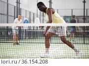 African american man playing paddle tennis. Стоковое фото, фотограф Яков Филимонов / Фотобанк Лори