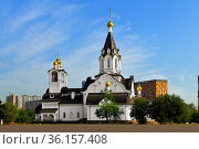 Stone white church of Holy Apostles Constantine and Elena in summer sunny day. Moscow, Russia. Редакционное фото, фотограф Валерия Попова / Фотобанк Лори