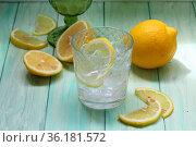 Homemade lemonade with ice cubes on green background. Стоковое фото, фотограф Марина Володько / Фотобанк Лори