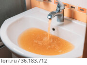 Rusty Water Pours From Tap. Water Pollution. Global Environment. Стоковое фото, фотограф Ryhor Bruyeu / easy Fotostock / Фотобанк Лори