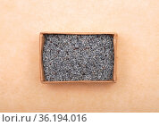 Mohn in Karton auf braunem Hintergrund - Poppy seeds in carton on... Стоковое фото, фотограф Zoonar.com/lantapix / easy Fotostock / Фотобанк Лори
