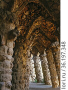 Stone arches and columns designed by architect Antoni Gaudi in Parc... Стоковое фото, фотограф Mehul Patel / age Fotostock / Фотобанк Лори