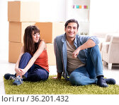 Young family moving to new house after final payment. Стоковое фото, фотограф Elnur / Фотобанк Лори