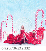 Concept fantasy winter portrait of young fashion woman with gift boxes... Стоковое фото, фотограф Zoonar.com/Svetlana Radayeva / easy Fotostock / Фотобанк Лори