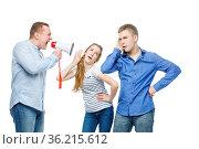 Father screaming through megaphone at teen age boy and girl. Isolated... Стоковое фото, фотограф Zoonar.com/Svetlana Mandrikova (SVETOGRAPHY) / easy Fotostock / Фотобанк Лори