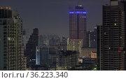 Timelapse of windows lights blinking in night Bangkok, Thailand. Стоковое фото, фотограф Данил Руденко / Фотобанк Лори