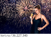 Young woman celebrating party with glass of champagne in her hands... Стоковое фото, фотограф Zoonar.com/Svetlana Radayeva / easy Fotostock / Фотобанк Лори