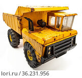 Rusted yellow toy truck isolated against white background. Стоковое фото, фотограф Zoonar.com/Yann Poirier / easy Fotostock / Фотобанк Лори