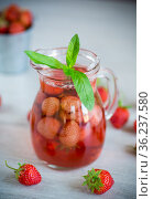 Sweet refreshing berry compote of ripe strawberries in a decanter. Стоковое фото, фотограф Peredniankina / Фотобанк Лори
