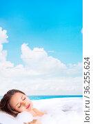 Young beautiful woman relaxing in bathtub in outdoor tropical spa... Стоковое фото, фотограф Zoonar.com/Svetlana Radayeva / easy Fotostock / Фотобанк Лори