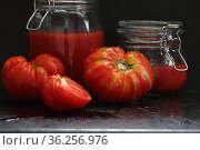 Still life with tomatoes, tomato juice and basil on a black background. Стоковое фото, фотограф Марина Володько / Фотобанк Лори