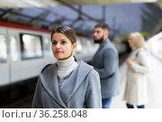 Female waiting for train on subway platform. Стоковое фото, фотограф Яков Филимонов / Фотобанк Лори