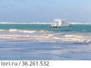 Coastal Caribbean landscape with white pleasure motorboat (2020 год). Стоковое фото, фотограф EugeneSergeev / Фотобанк Лори