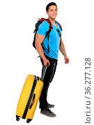 Junger Mann zieht Koffer Reise reisen verreisen Urlaub jung lachen... Стоковое фото, фотограф Zoonar.com/Markus Mainka / easy Fotostock / Фотобанк Лори