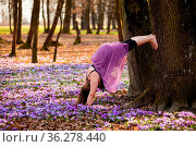 Young happy woman enjoying the nature in the spring forest and feeling... Стоковое фото, фотограф Zoonar.com/Oksana Shufrych / easy Fotostock / Фотобанк Лори