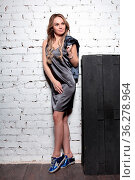 Young beautiful lady posing in studio dressed in sportswear, short... Стоковое фото, фотограф Zoonar.com/Sergey Sukhorukov / easy Fotostock / Фотобанк Лори