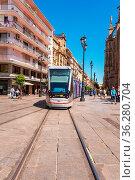Seville, Spain - May 20, 2019: A modern comfortable tram on the city... Стоковое фото, фотограф Zoonar.com/DAVID HERRAEZ CALZADA / easy Fotostock / Фотобанк Лори