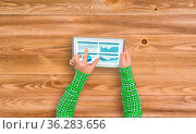 Top view of girl hands using tablet pc with diagrams and graphs on... Стоковое фото, фотограф Zoonar.com/Aleksandr Khakimullin / easy Fotostock / Фотобанк Лори