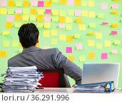 Businessman having trouble with his priorities. Стоковое фото, фотограф Elnur / Фотобанк Лори