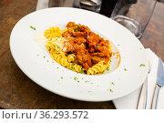 Italian fusilli pasta with pork and cheese. Стоковое фото, фотограф Яков Филимонов / Фотобанк Лори