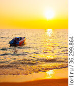 Sea view with boat at sundown. Стоковое фото, фотограф Zoonar.com/Roman Sigaev / easy Fotostock / Фотобанк Лори