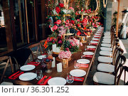 Wedding table flowers with fruits and berries decor in red white pink... Стоковое фото, фотограф Zoonar.com/Max / easy Fotostock / Фотобанк Лори