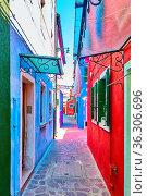 Perspective of narrow old street in Burano in Venice, Italy - Colorful... Стоковое фото, фотограф Zoonar.com/Roman Sigaev / easy Fotostock / Фотобанк Лори